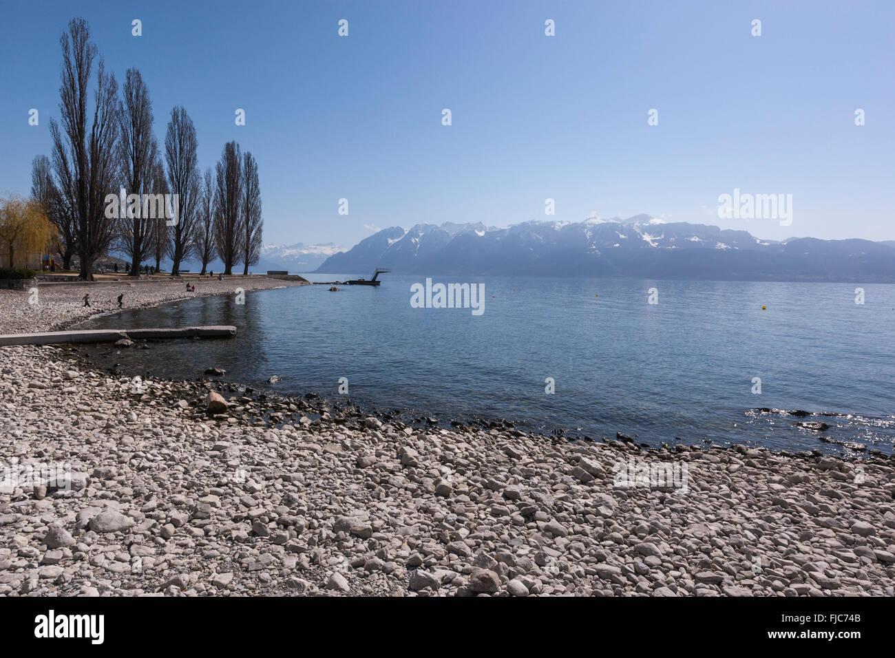 Pebble beach in Lake Geneva, Lutry, Vaud, Switzerland Stock Photo