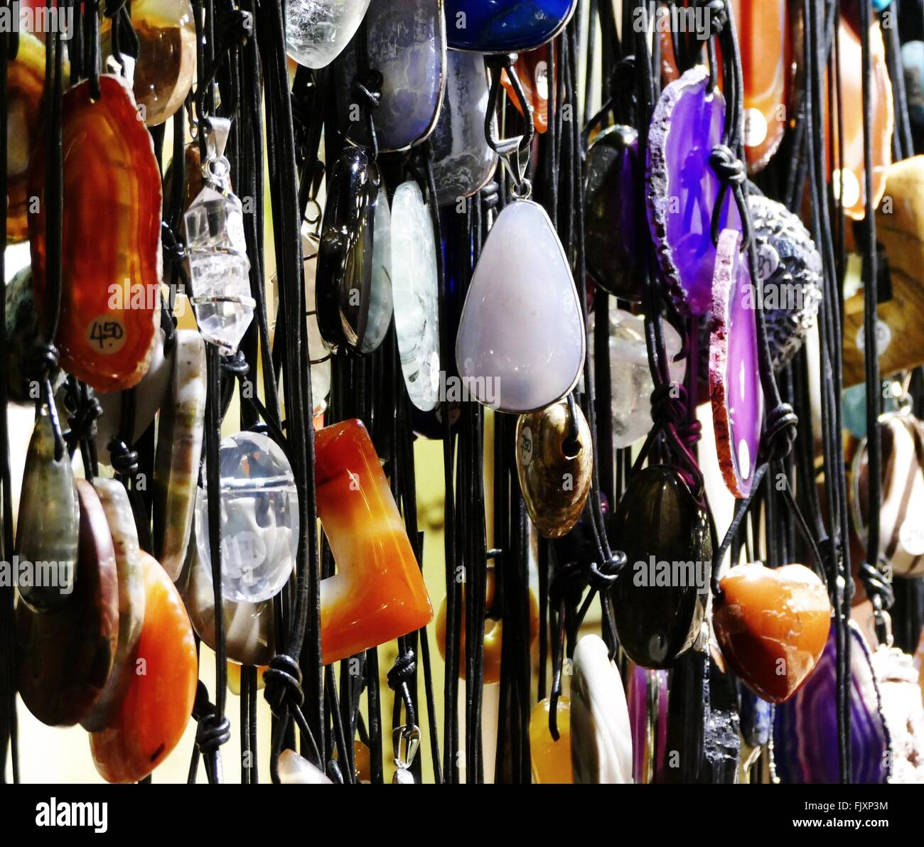Full Frame Shot Of Various Jewelries For Sale At Market Stall - Stock Image