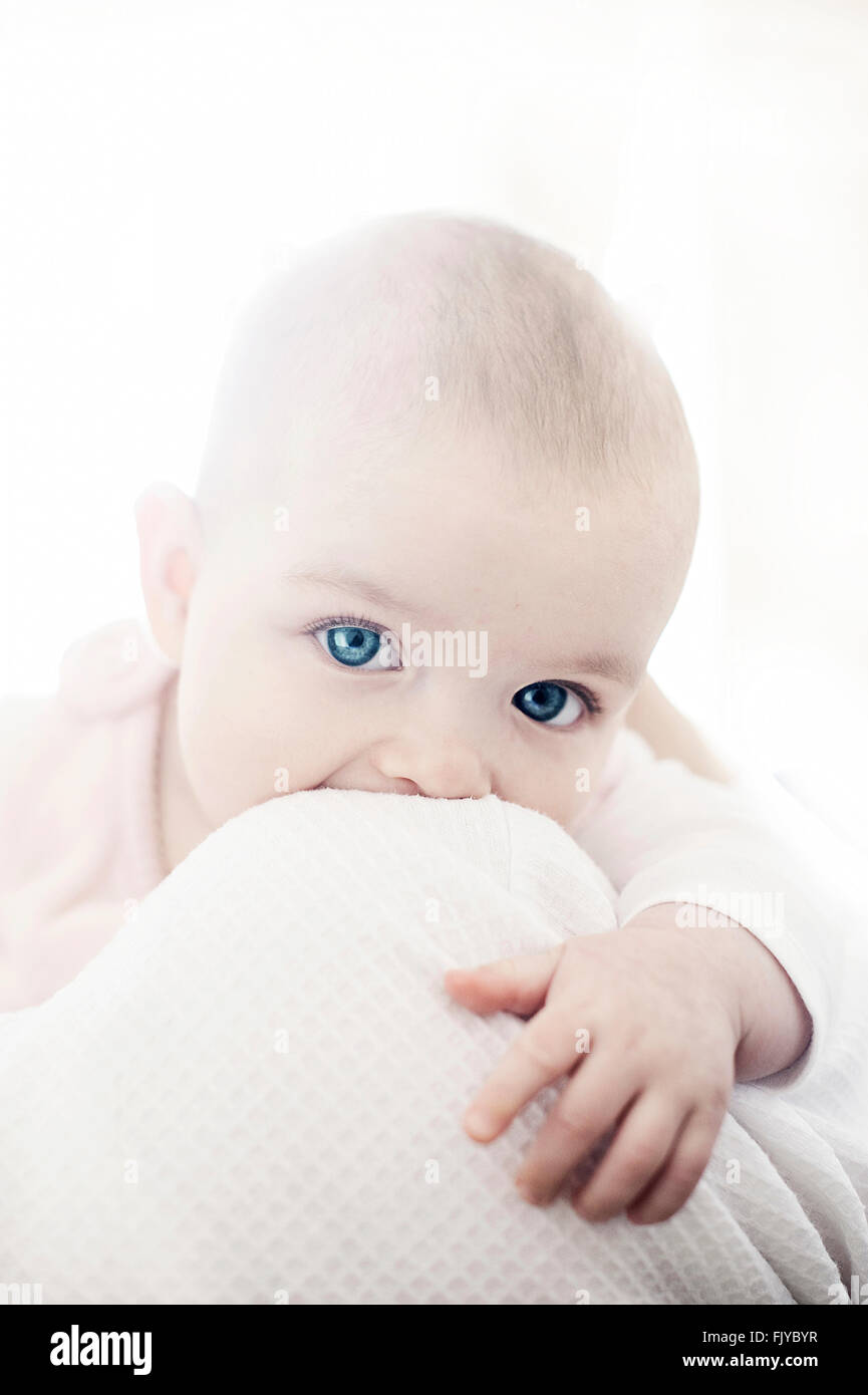 beautiful baby girl in her mother's arms - Stock Image