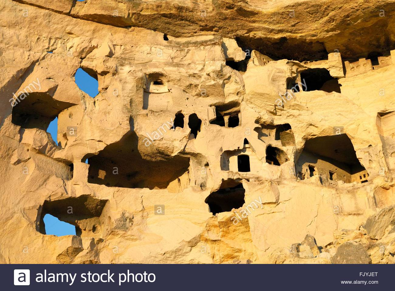 Part of cliff dwelling complex of ancient Christian churches and houses in village of Cavusin near Goreme, Cappadocia, - Stock Image