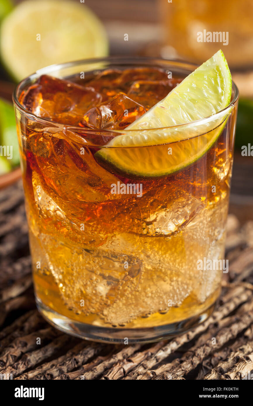 Dark and Stormy Rum Cocktail with Lime and Ginger Beer - Stock Image