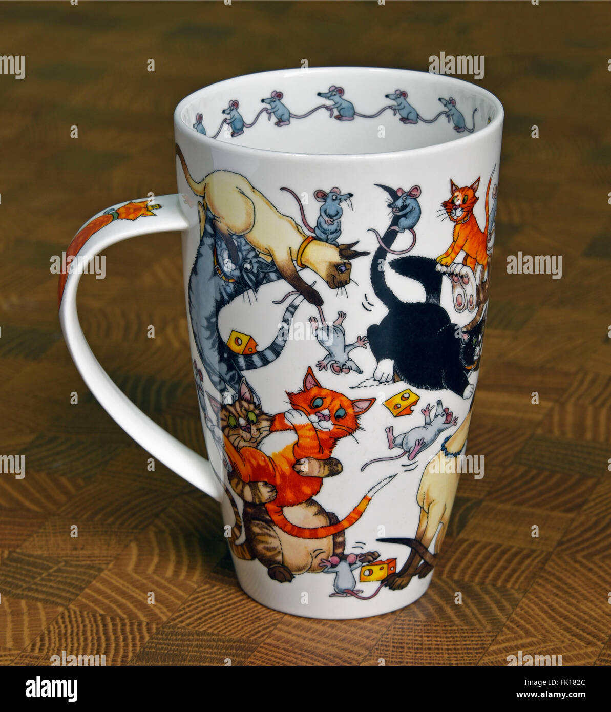 "Ceramic Mug. ""Pussy Galore"", design by Cherry Denman. Dunoon Fine Bone China, England. Stock Photo"