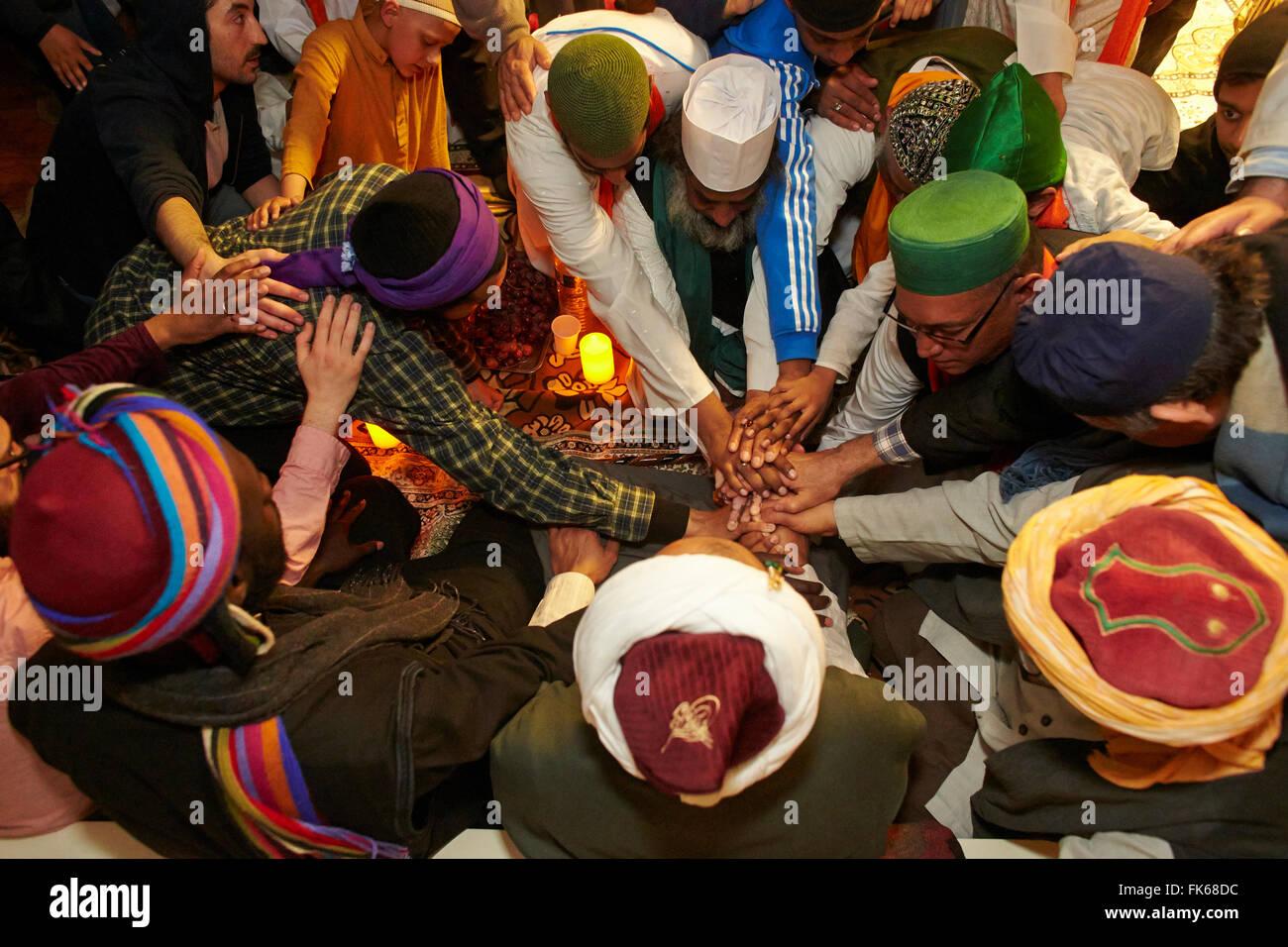 Naqshbandi Sufis joining hands, Paris, France, Europe - Stock Image