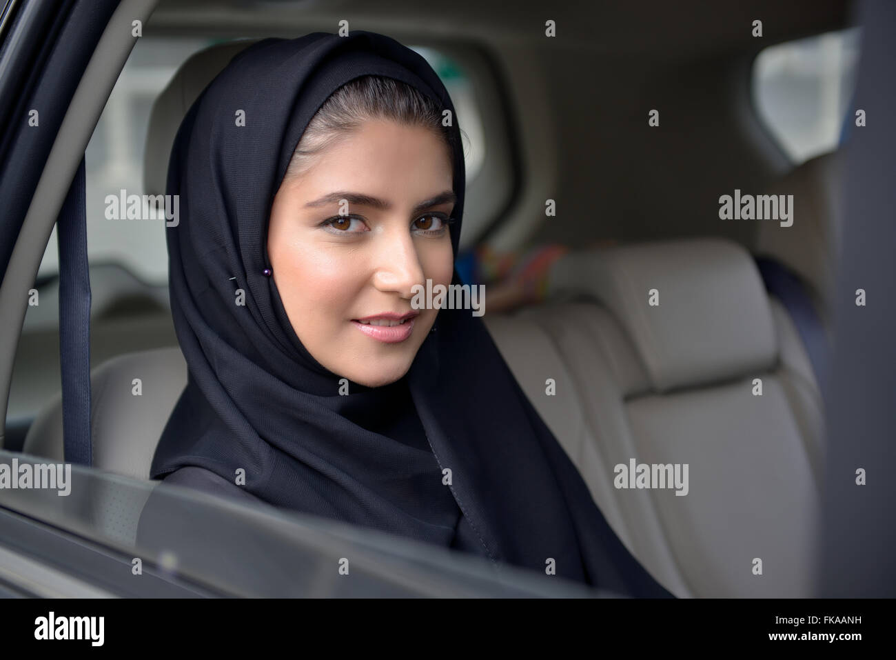 Young Emarati business woman in the car - Stock Image