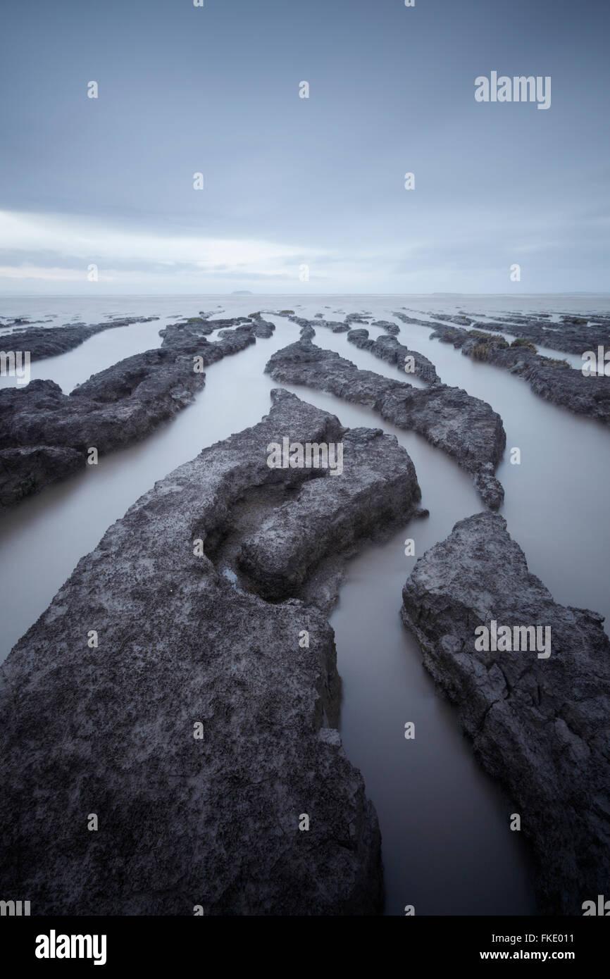 Mudflats at Sand Bay. Semi submerged at high neap tide. Somerset. UK. - Stock Image