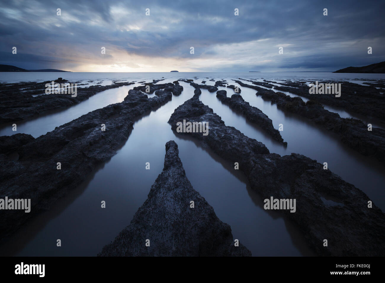 Mudflats at Sand Bay. Semi submerged at high neap tide. Somerset. UK. - Stock Image