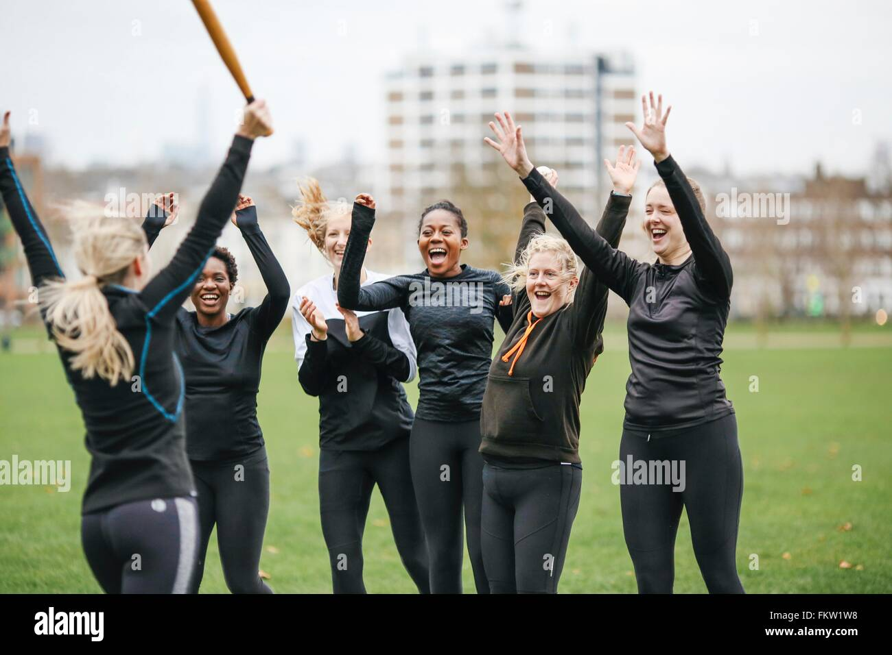 Female rounders team celebrating at rounders match - Stock Image