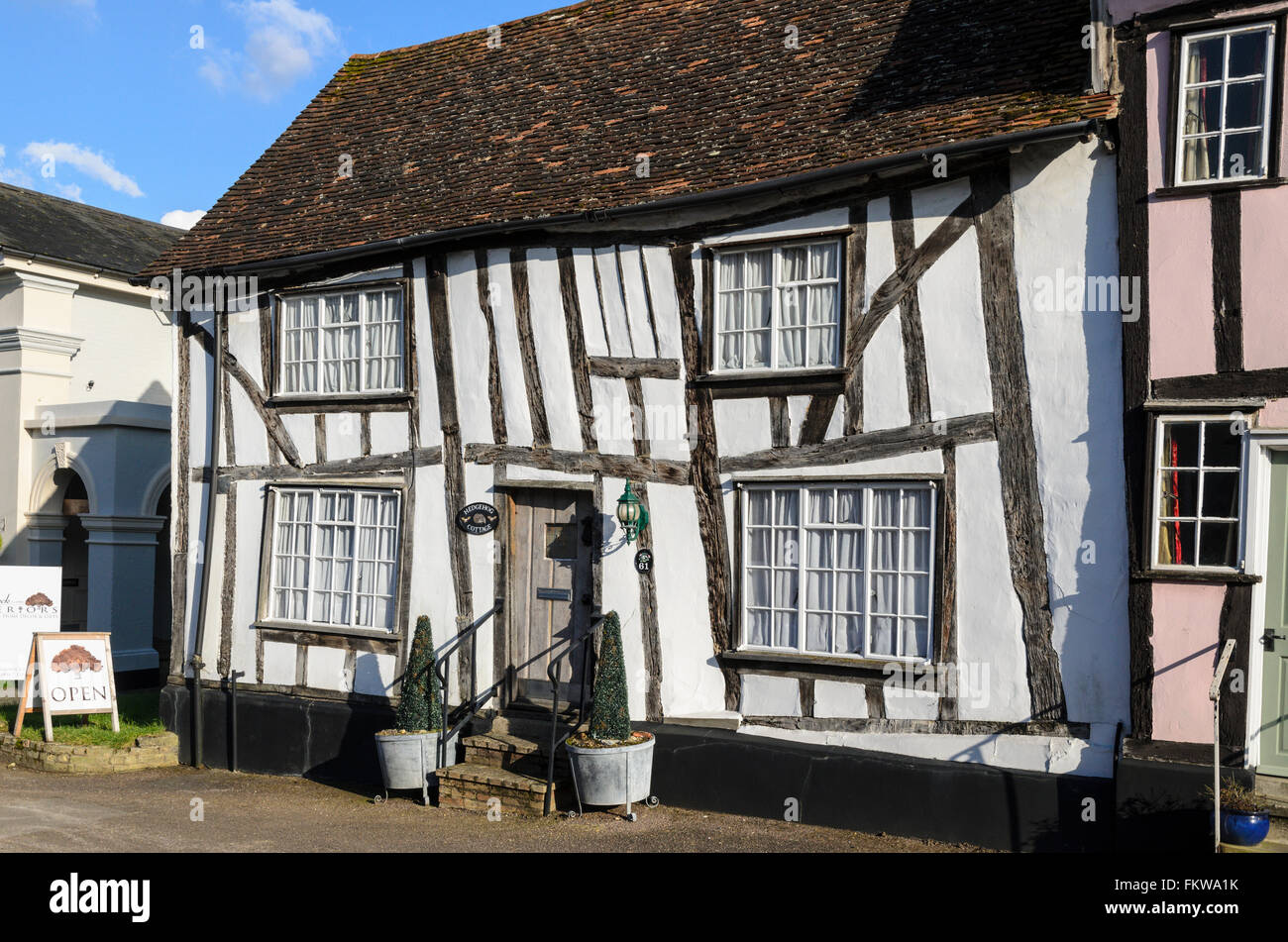 A medieval half timbered building on High Street, Lavenham, Suffolk, England, United Kingdom. - Stock Image