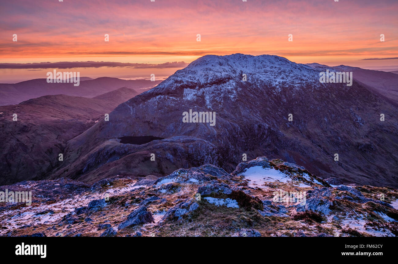 Winter dawn over Barrslievenaroy, Maumturk Mountains, Connemara, County Galway, Ireland. - Stock Image