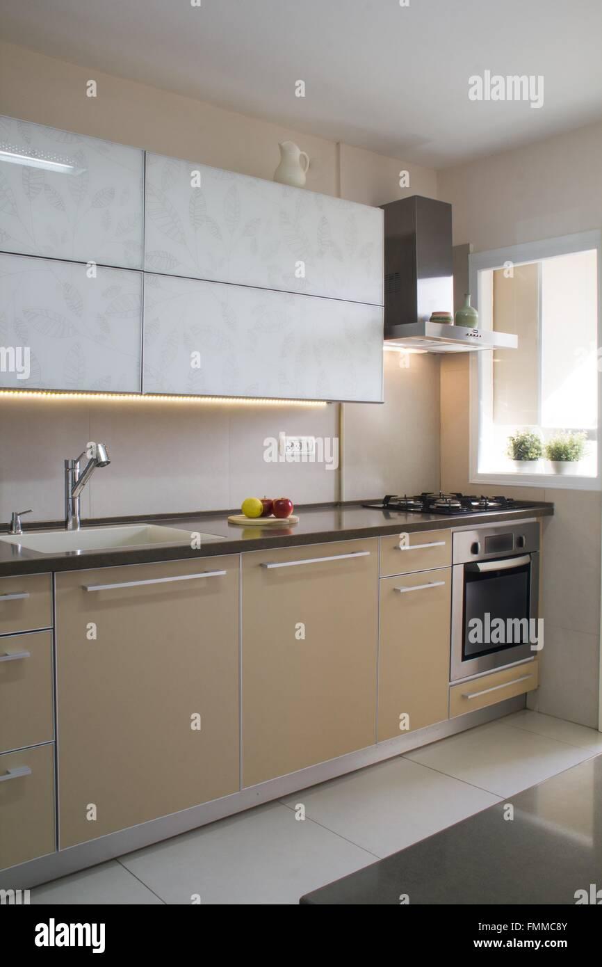 Modern kitchen interior in beige and cream colors & Modern kitchen interior in beige and cream colors Stock Photo ...