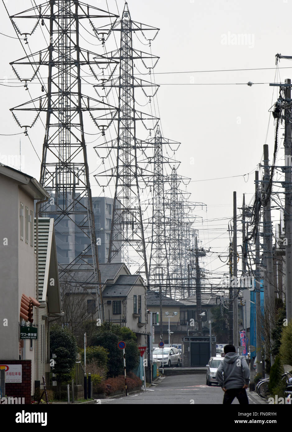 Saitama City, Japan. 13th Mar, 2016. High-voltage power lines are ...