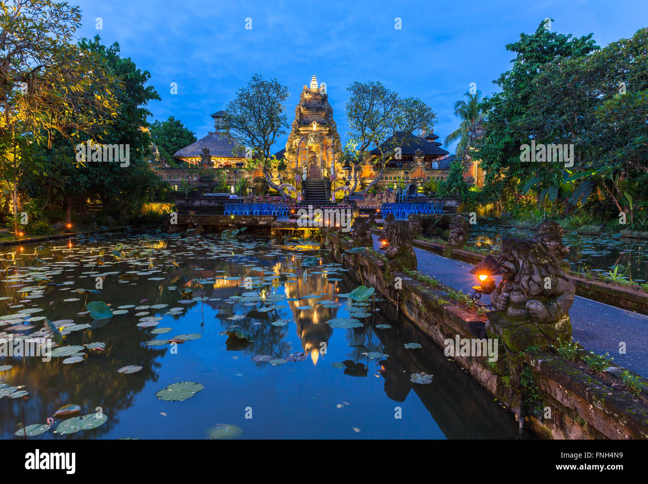 Pura Saraswati Temple with beatiful lotus pond at dusk before the dancing show, Ubud, Bali, Indonesia Stock Photo