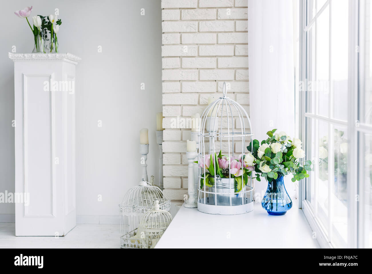 Flowers on the windowsill in studio Stock Photo