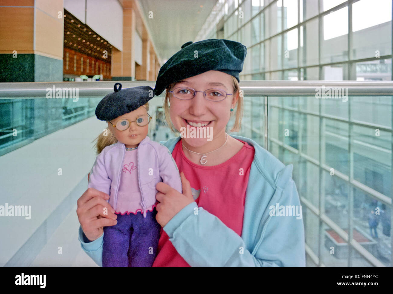a-little-girl-and-her-doll-with-matching-berets-in-the-airport-logan-FNN4YC.jpg