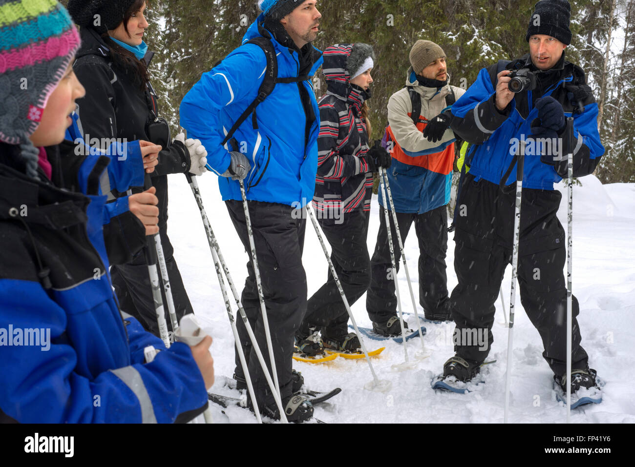 Group of tourists in Salla doing a snowshoe trip to Ice Wall, Salla, Lapland, Finland. You can experience the winter - Stock Image