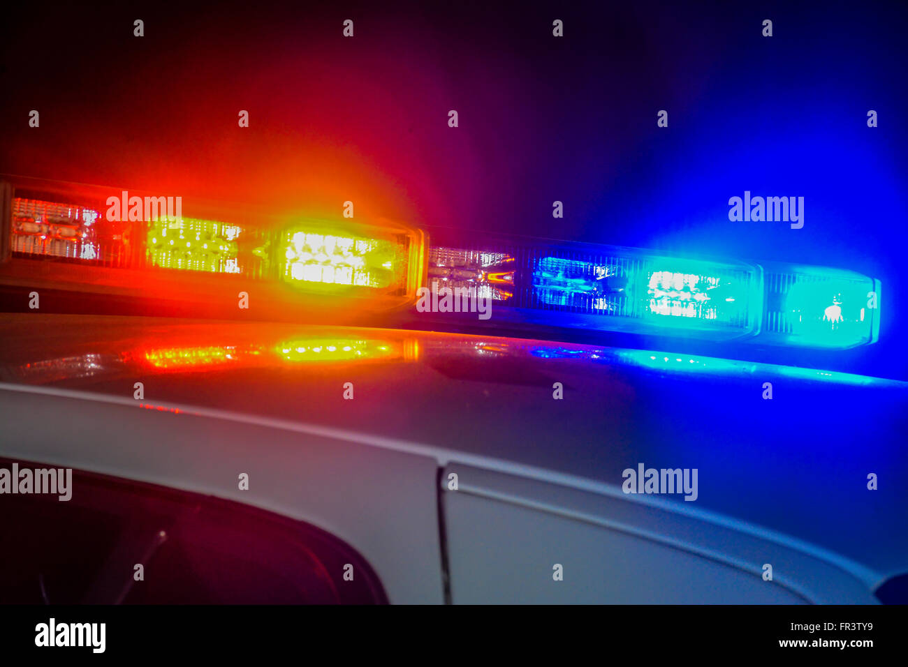 Captivating Red And Blue Flashing Police Car Lights Atop A Patrol Car At Night While  Conducting Law Enforcement Business