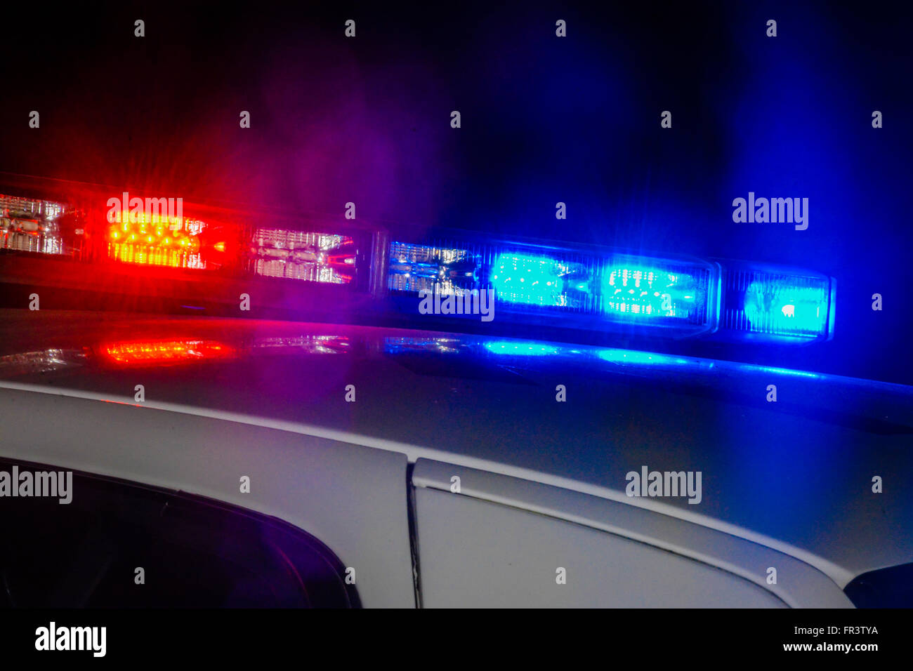 Elegant Red And Blue Flashing Police Car Lights Atop A Patrol Car At Night While  Conducting Law Enforcement Business