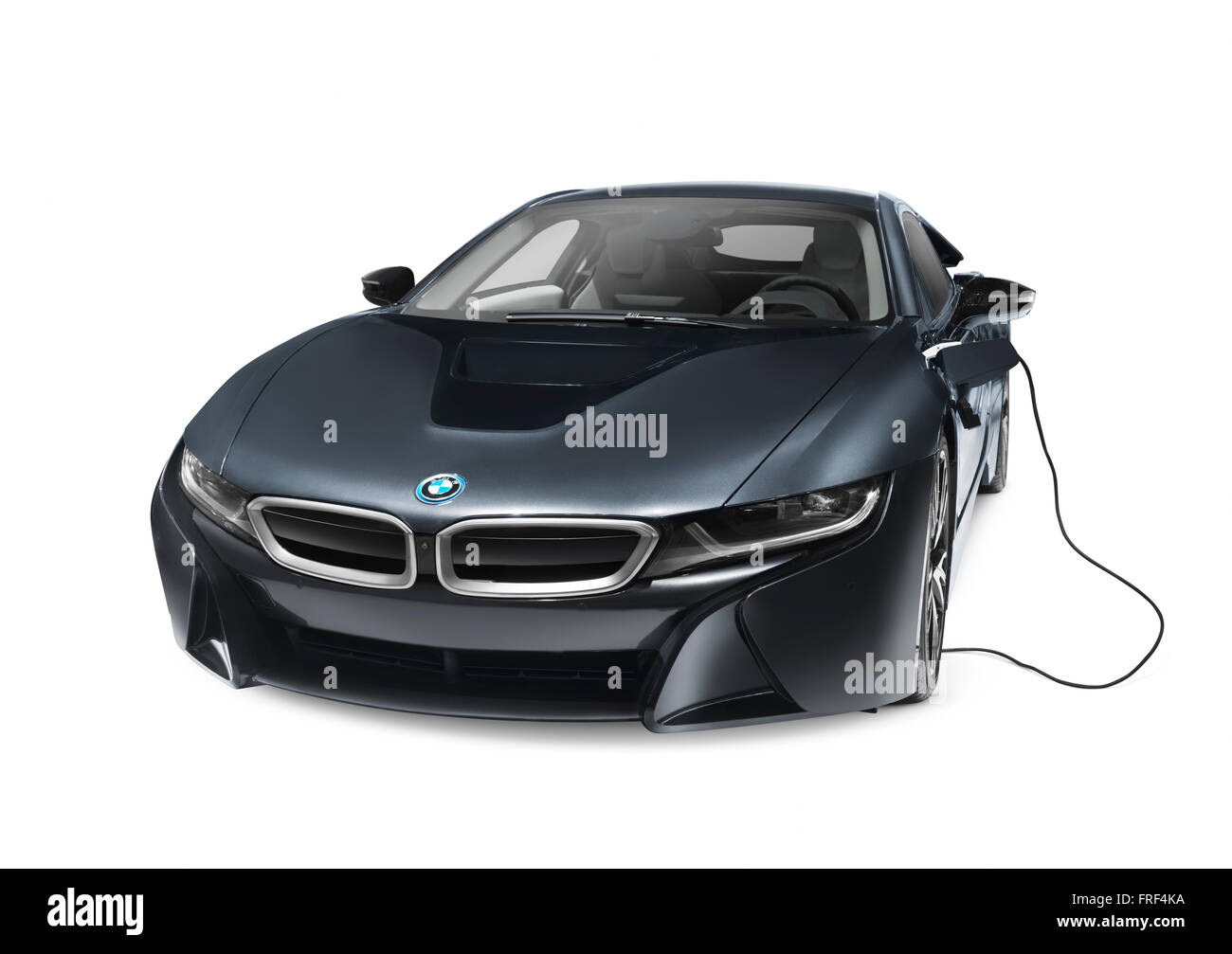 Black 2016 BMW i8 plug-in hybrid electric luxury sports car with charging cord isolated on white background with - Stock Image