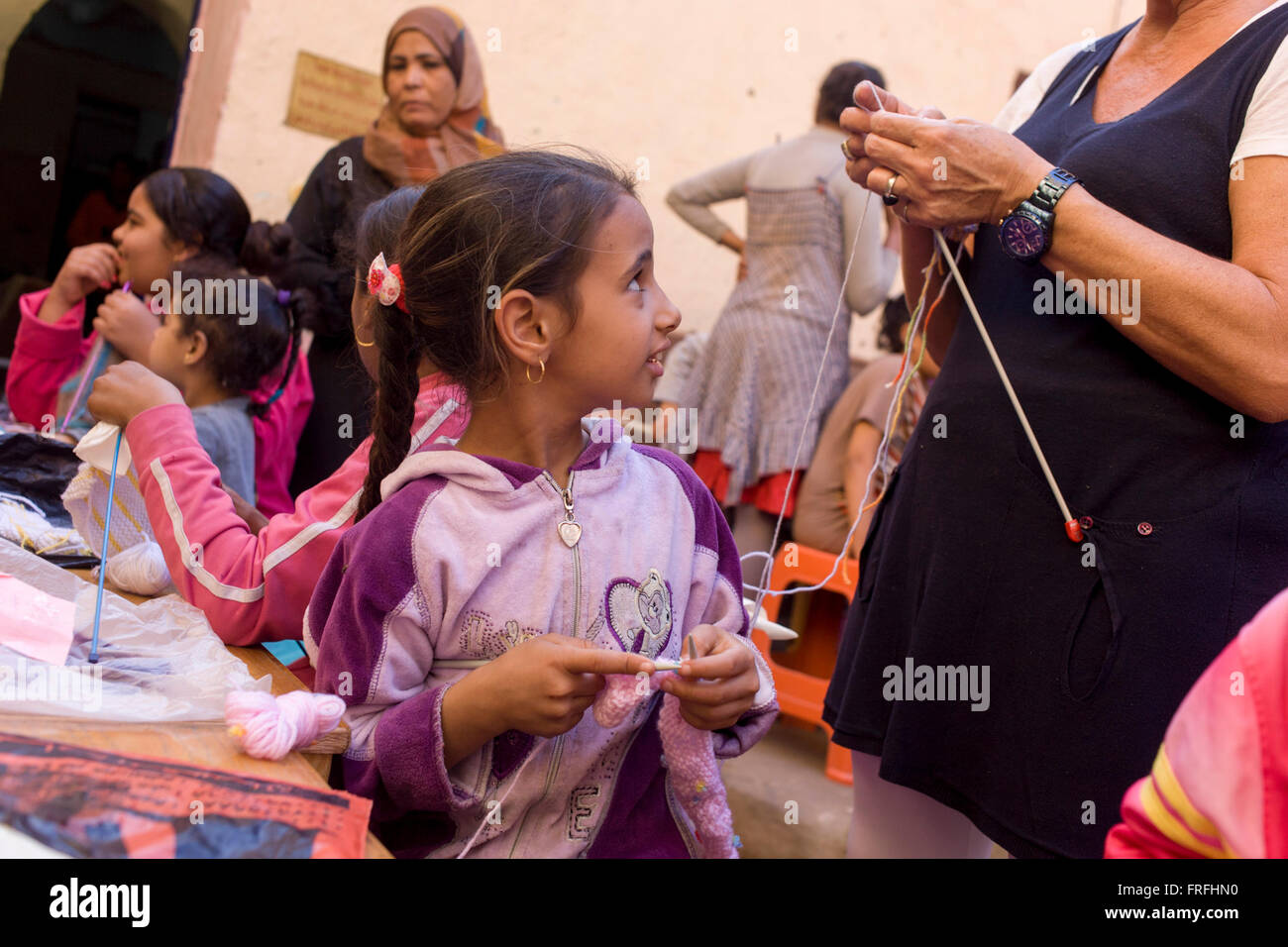 young-egyptian-girls-learn-to-knit-with-