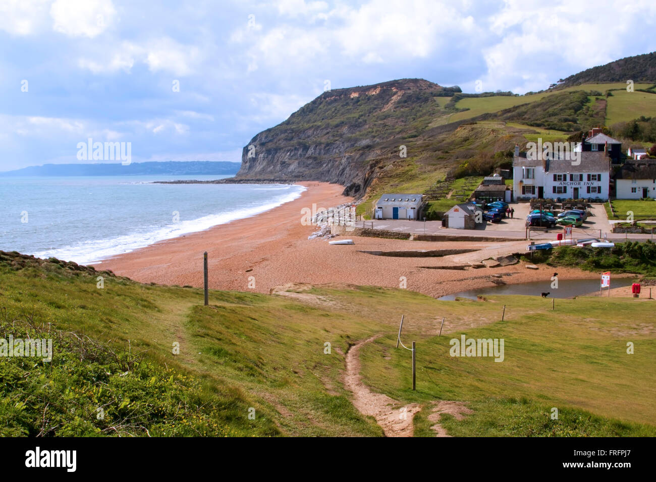 looking down on to the Anchor Inn at Seatown on the Jurassic Coast, with a view of Golden Cap in the background, Stock Photo