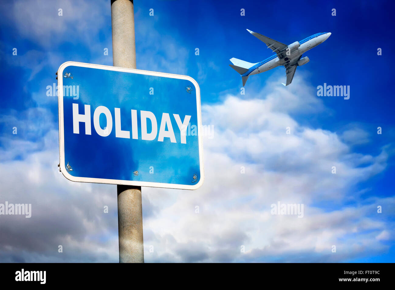 Holiday sign and jet plane against a blue sky Stock Photo