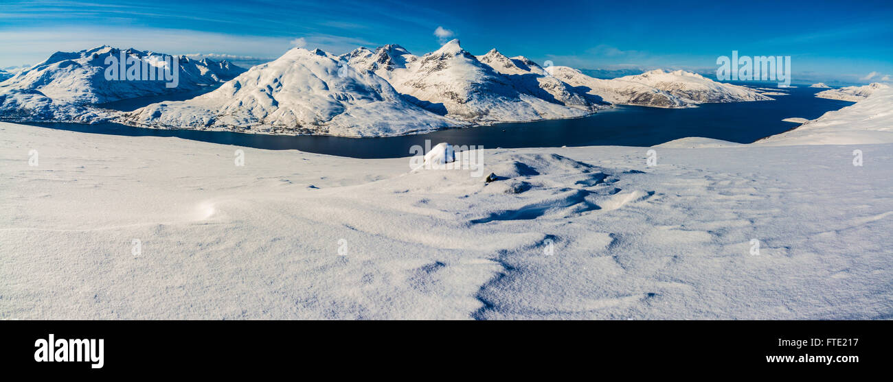 Panoramic view from Rodtinden with views towards Store Blamann and the open ocean, Kvaloya Troms, Northern Norway - Stock Image