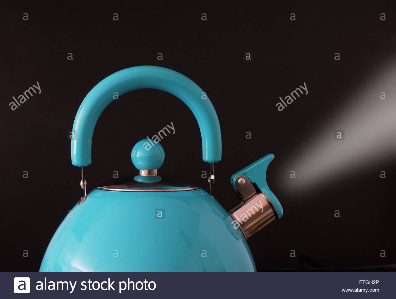 Closeup of boiling kettle steam coming from the spout against black background Stock Photo