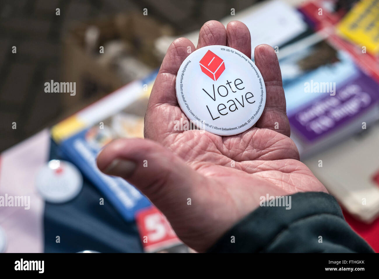A badge supporting the UK exit from the European Union held in a hand. - Stock Image