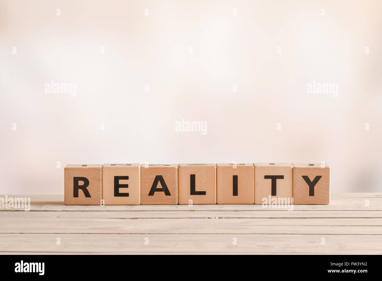 Reality sign on a table of wood in a room - Stock Image