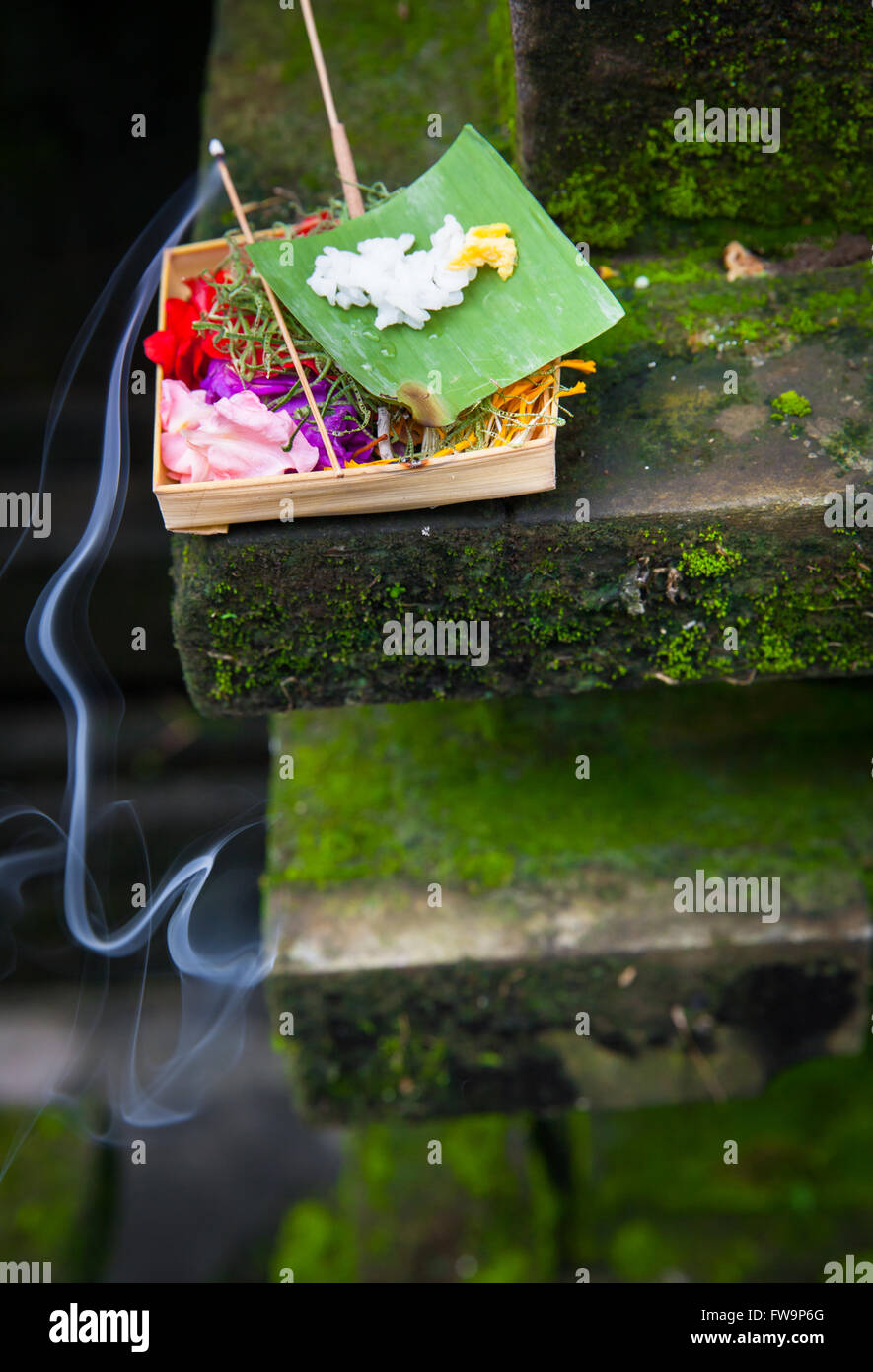 Box with traditional balinese morning offerings or Canang sari, Ubud, Bali, Indonesia Stock Photo
