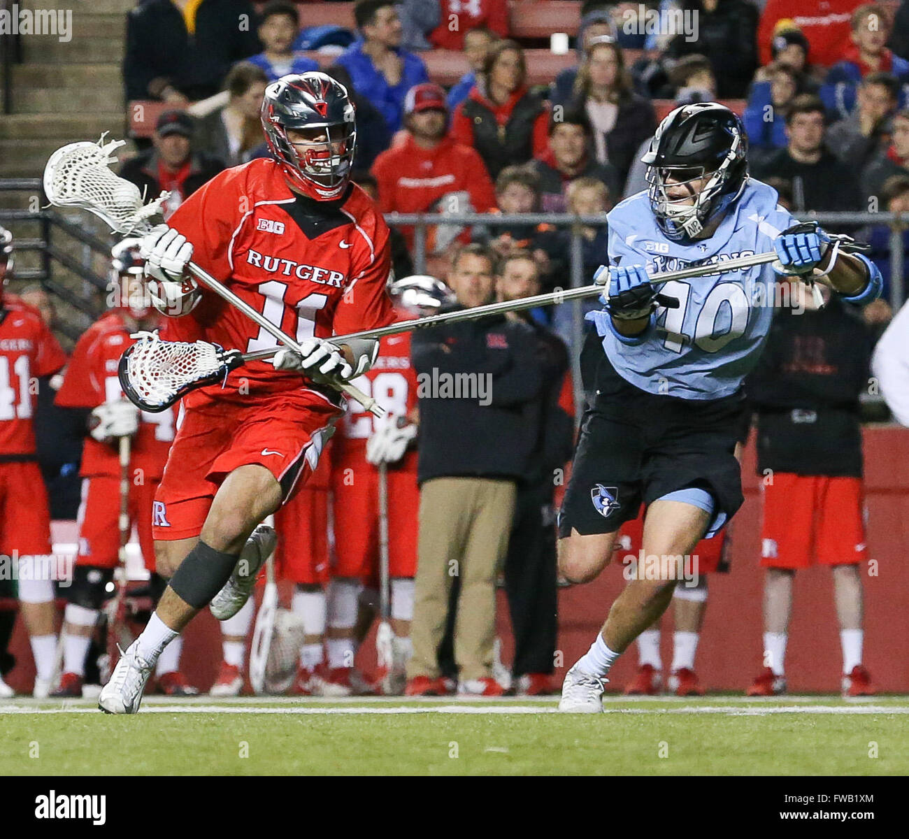 Piscataway, NJ, USA. 2nd Apr, 2016. Austin Spencer (40) tries to defend Jeff George (11) during an NCAA Lacrosse Stock Photo
