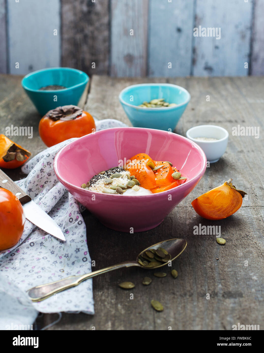 Breakfast bowl with yogurt, persimmon and superfoods - Stock Image