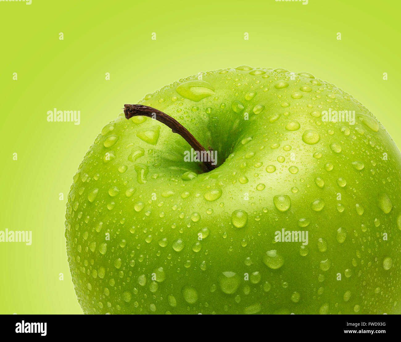 Perfect Fresh Green Apple Isolated on Green Background in Full Depth of Field with Clipping Path. - Stock Image