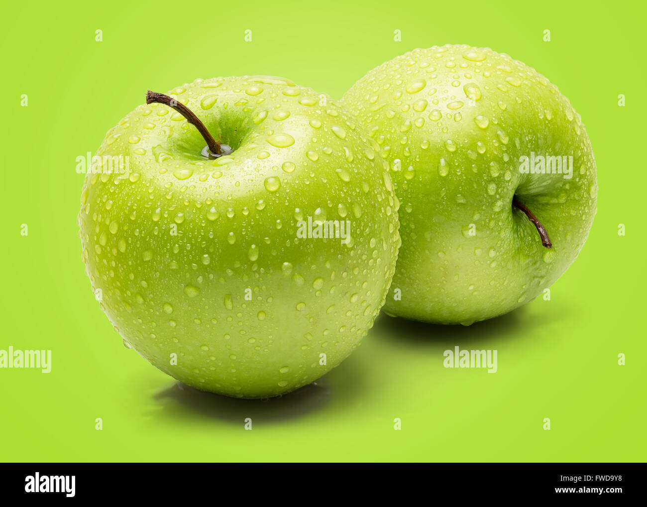 Perfect Fresh Green Apple Isolated on Green Background in Full Depth of Field. - Stock Image
