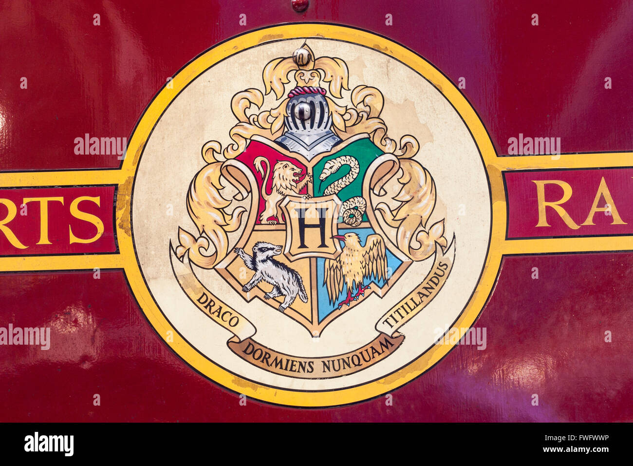 Hogwarts Latin motto on Hogwarts Express, the train used in Harry Potter films. - Stock Image