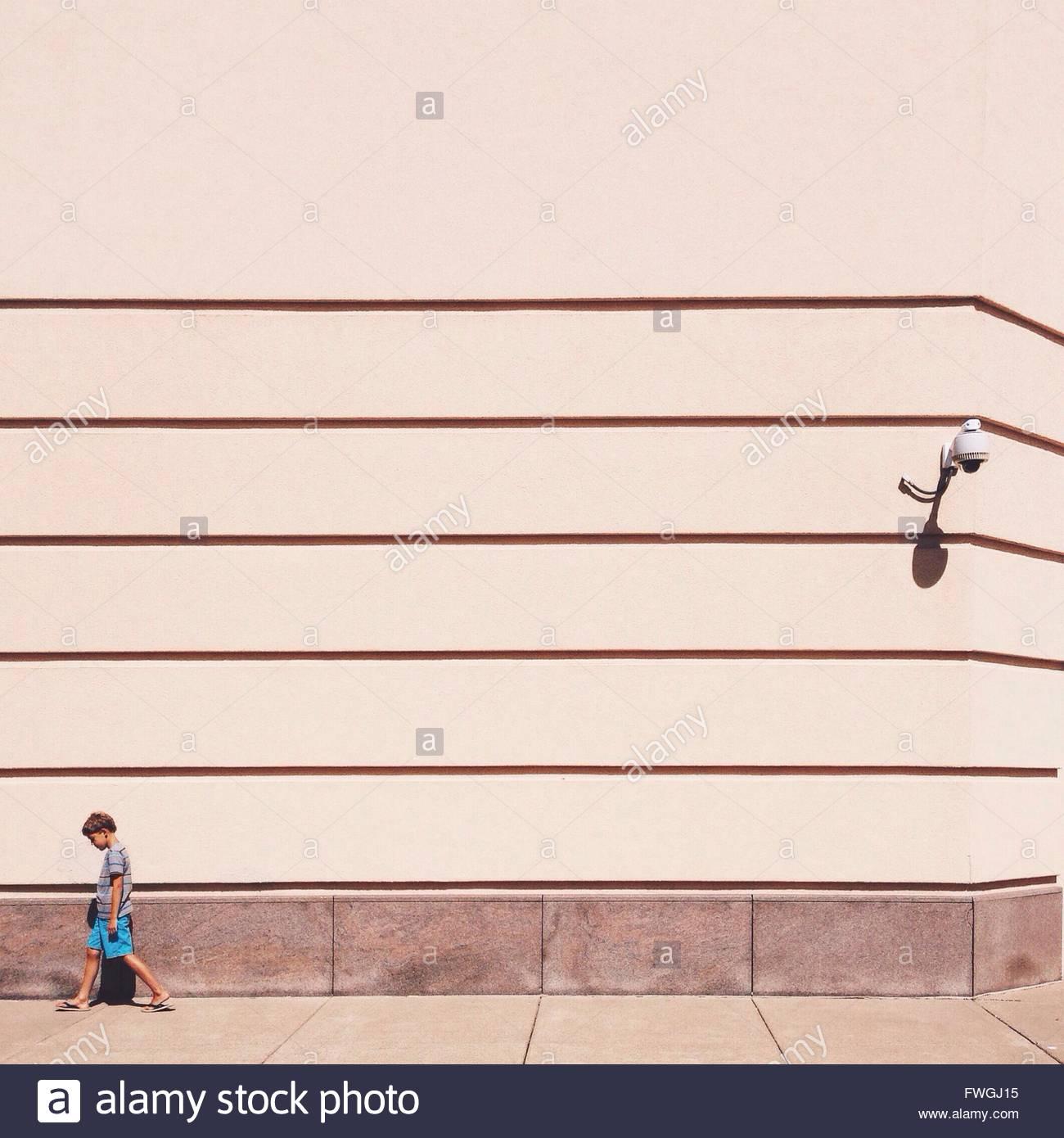 Boy walking alone - Stock Image