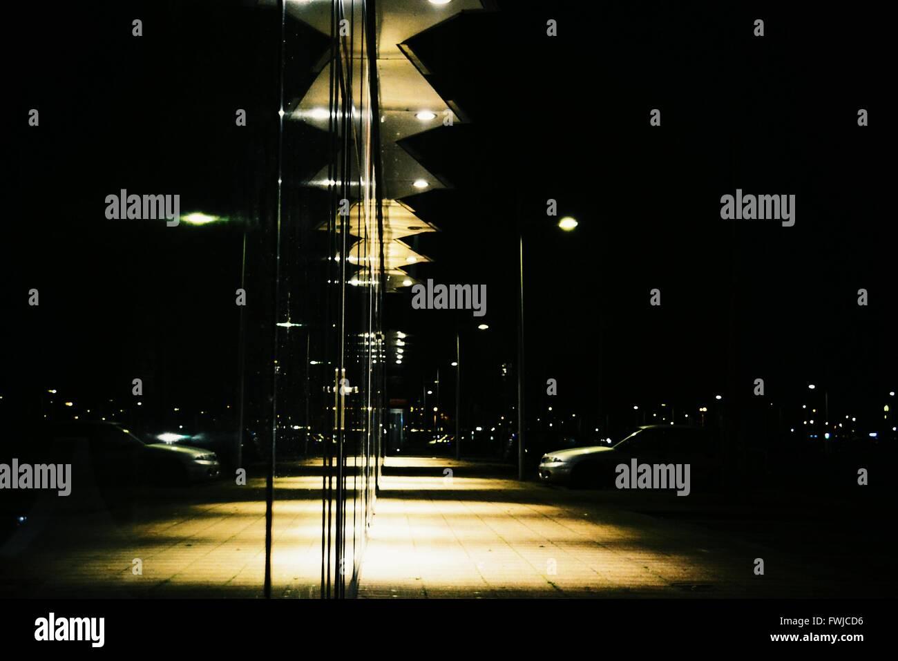 Illuminated Lighting Equipment On Glass Buildings At Night - Stock Image