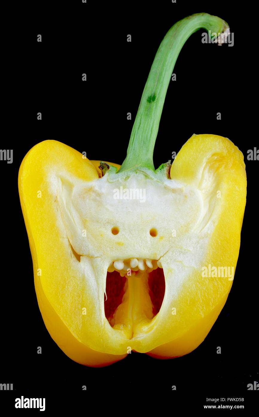Cross Section Of Yellow Bell Pepper Against Black Background - Stock Image