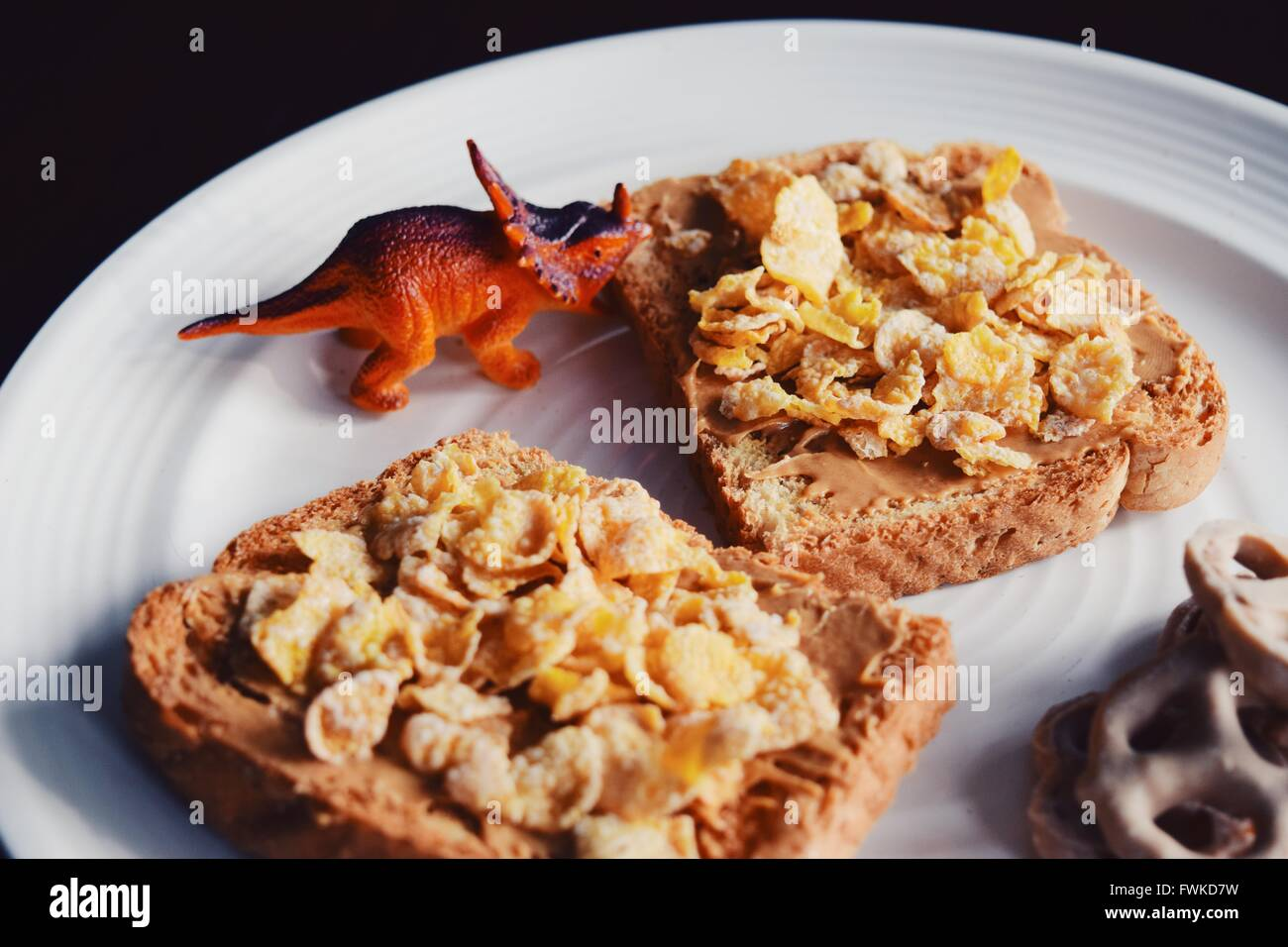 Dinosaur Toy With Breakfast Served In Plate Stock Photo
