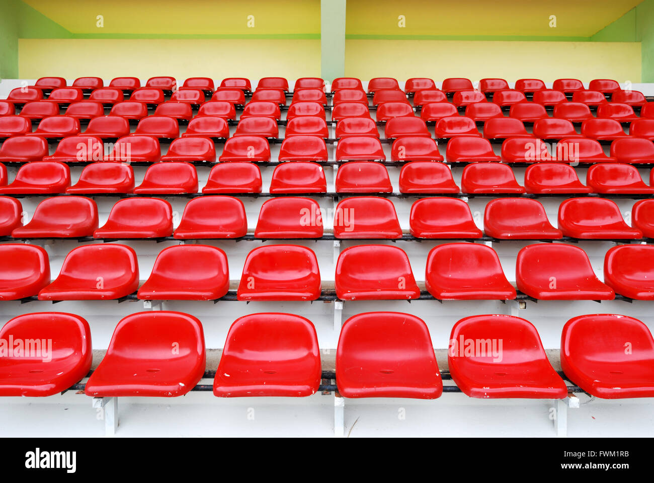 Red Bleachers In Sport Stadium - Stock Image