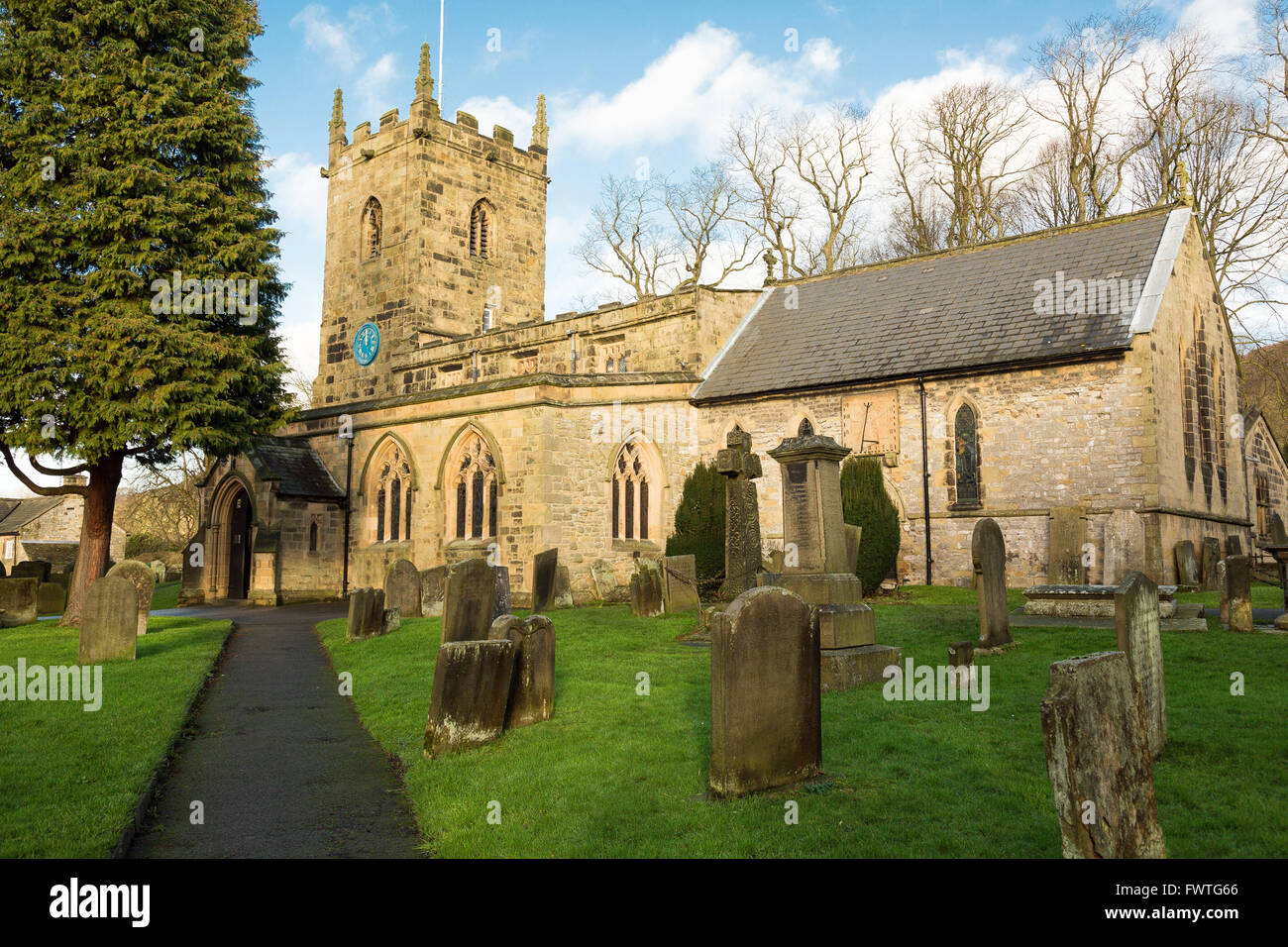 The parish church of St. Lawrence in the Peak District village of Eyam in Derbyshire, UK. - Stock Image