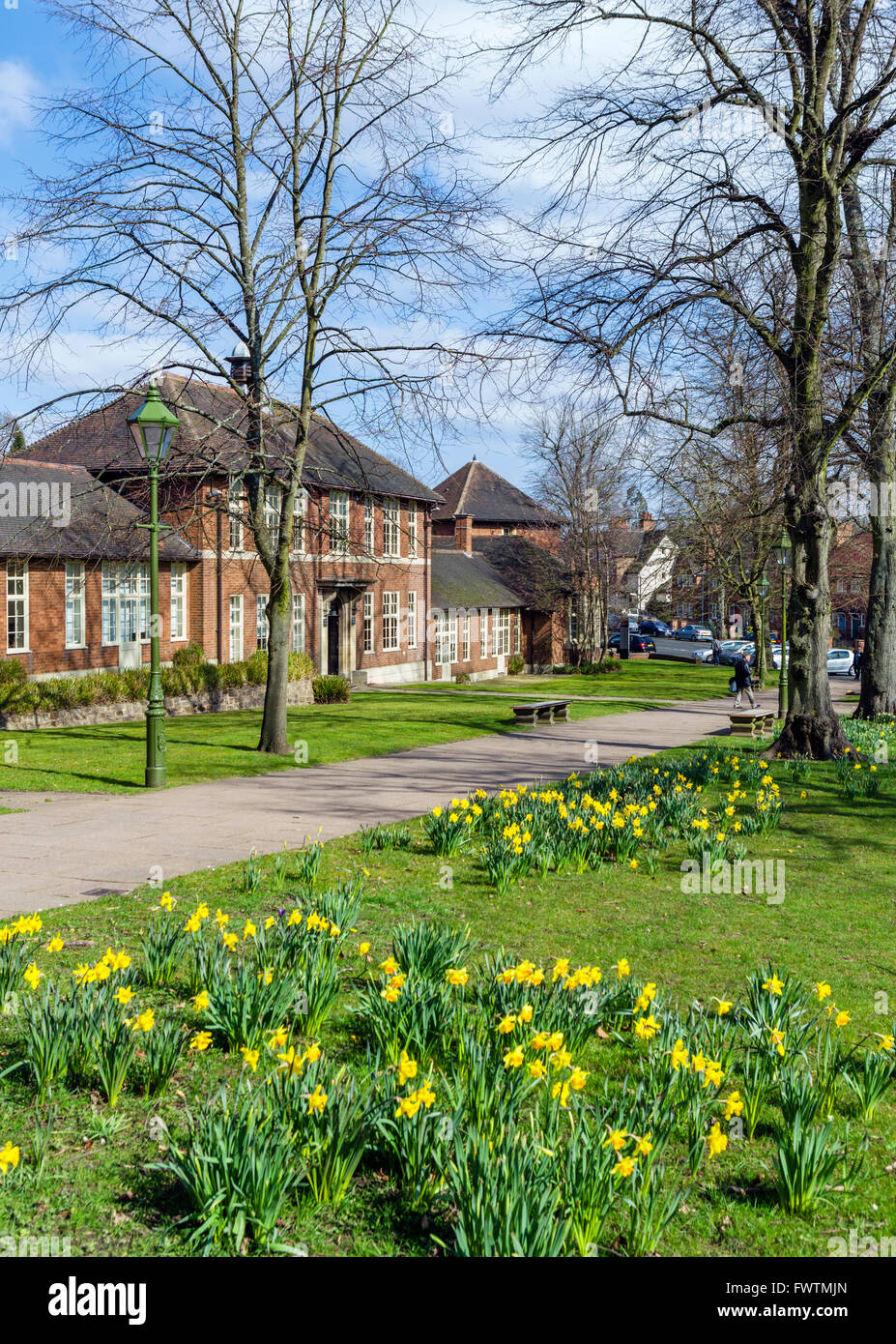 Bournville Village Green with the Day Continuation School on the left, Bournville, Birmingham, West Midlands, UK - Stock Image