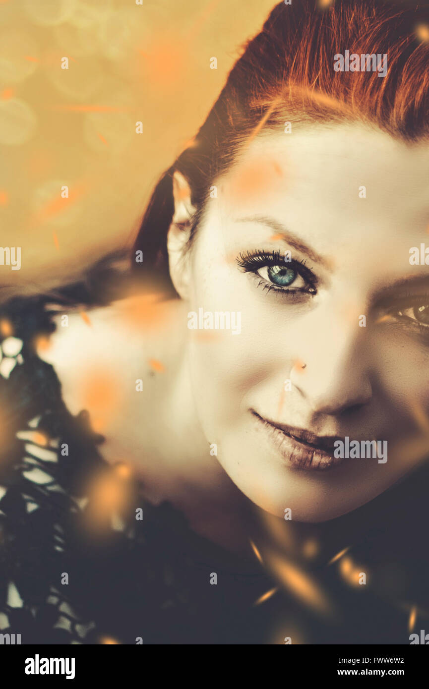portrait of the beautiful woman with falling leaves - Stock Image