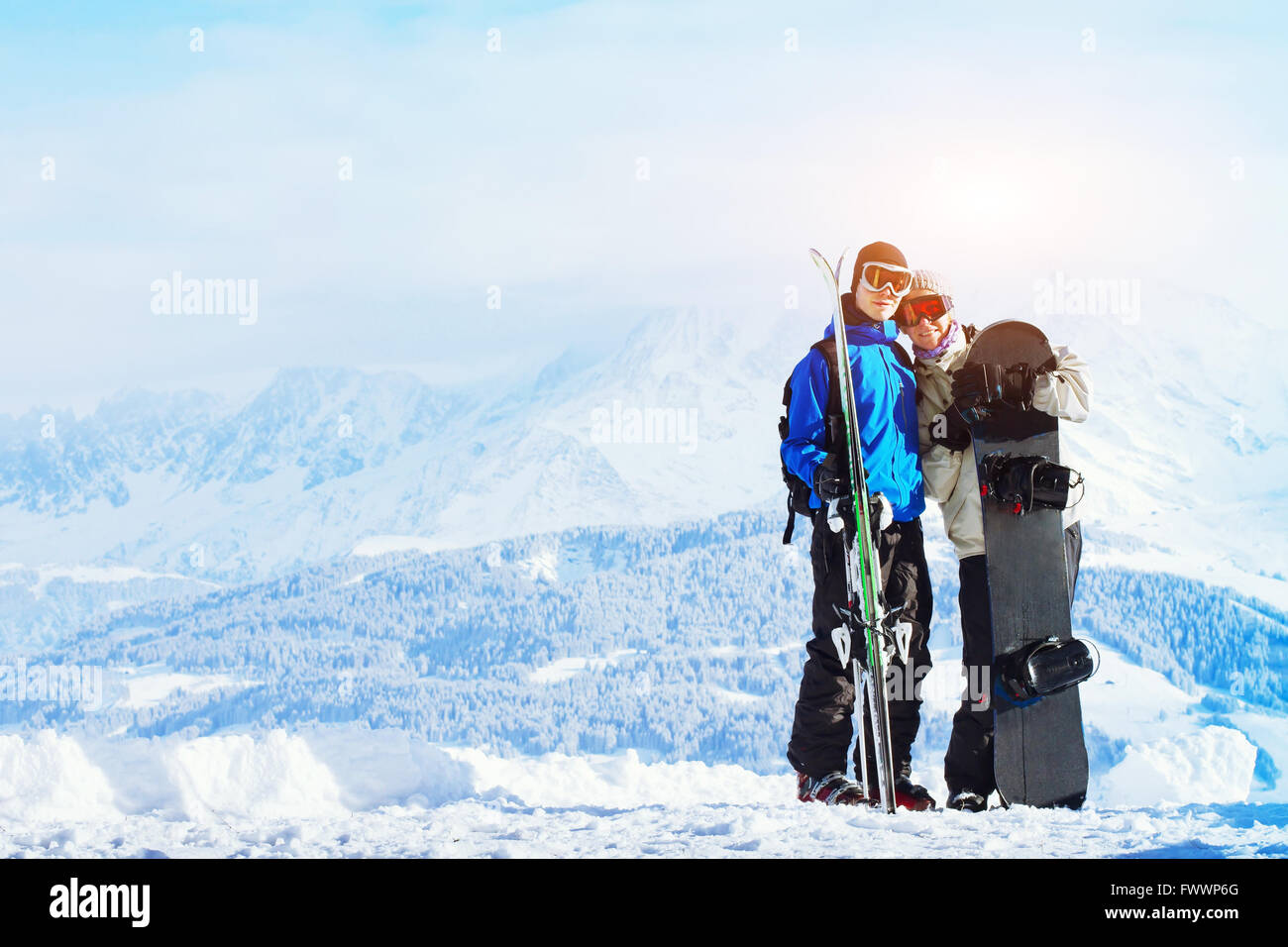 winter sports, happy young family at ski holidays - Stock Image