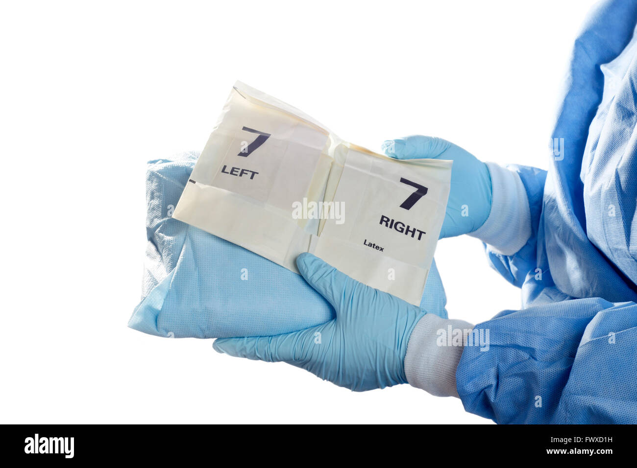 Operating room technician holds gown and gloves for surgeon Stock ...