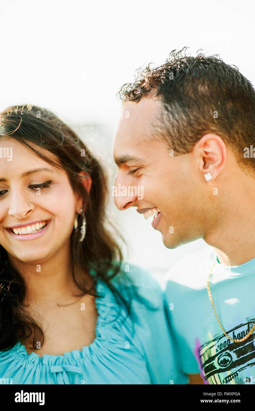 Sweden, Vastra Gotaland, Gothenburg, Young couple smiling - Stock Image