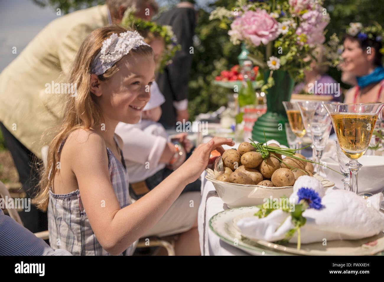 Sweden, Skane, Children (6-11 months, 8-9) celebrating traditional festival - Stock Image