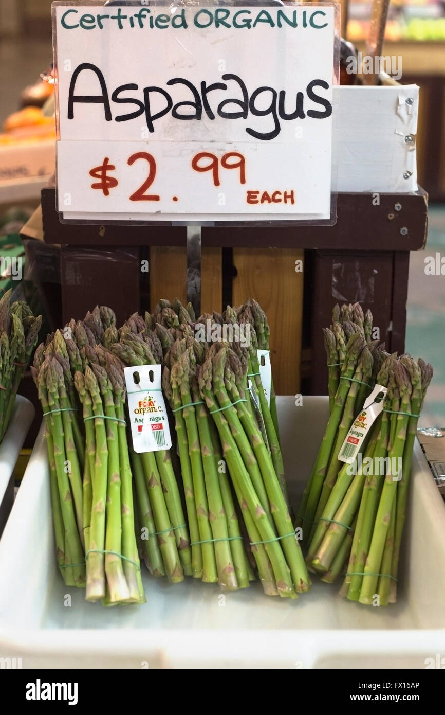 Fresh organic asparagus for sale at St Lawrence Market with price in Canadian dollars - Stock Image