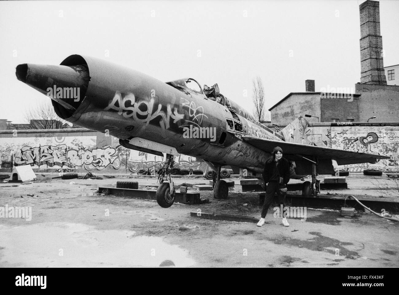 archive-image-of-a-young-woman-in-front-of-soviet-mig-21-fighter-mutoid-FX43KF.jpg