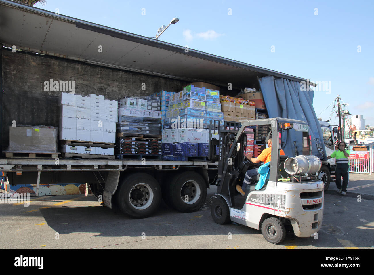unloading a truck at sydney fish market australia Stock Photo